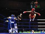 Vasyl Lomachenko of Ukraine (red) celebrates victory against Khedafi Djelkhir of France (blue) in the Men's Feather (57kg) Final Bout held at Workers' Indoor Arena on Day 15 of the Beijing 2008 Olympic Games on August 23, 2008 in Beijing, China.