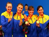 Ukraine team mates (L-R) Olha Zhovnir, Olga Kharlan, Halyna Pundyk and Olena Khomrova celebrate winning the gold medal in the Women's Team Sabre event.