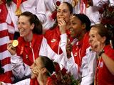 Katie Smith, Sue Bird, Diana Taurasi and Kara Lawson celebrate after winning the gold medal against Australia during the women's basketball gold medal game.