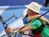 Anton Karoukin of Belarus (right) hugs Gloria Filippi of Italy after winning the Archery Mixed Team Gold Medal match. Filippi and Karoukin won 7-3 .