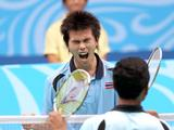 Pisit Poodchalat of Thailand reacts during the boys' singles final-gold medal match of badminton
