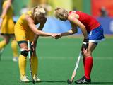 Alex Danson #15 of Great Britain congratulates Casey Eastham #4 on the 2-0 win in the women's classification hockey match at the Beijing 2008 Olympic Games. Australia went on to finish 5th overall.