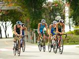 (From left to right) Michael Gosman of Australia, Lee Ji Hong of Korea, Thomas Jurgens of Belgium, Andriy Sirenko of Ukraine, and Miguel Valente Fernandes of Portugal compete in the cycle leg of the 4 x Mixed Team Triathlon Relay.