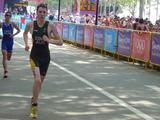 Canberra athlete Michael Gosman completes his final lap of the 5km run in the men's individual triathlon at the Singapore 2010 Youth Olympic Games.