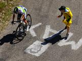 A fan encourages Matt Goss riding for Orica-GreenEdge on the climb of the Col du Grand Columbier in stage ten of the 2012 Tour de France from Macon to Bellegarde-Sur-Valserine on July 11, 2012 in La Sapette, France.