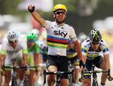 World Road Race Champion Mark Cavendish of Great Britain and SKY Procycling celebrates winning stage two of the 2012 Tour de France from Vise to Tournai on July 2, 2012 in Tournai, Belgium. Australia's Matt Goss for Orica Greenedge on the right of shot was third.