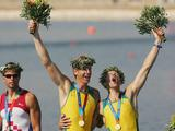 Drew Ginn (L) and James Tomkins celebrate with their Gold medals after the men's pair rowing final during the Athens 2004 Summer Olympic Games.