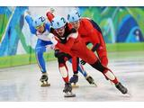 Charles Hamelin (C) of Canada leads Nicola Rodigari (L) of Italy and Jon
