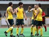 Jeremy Hayward, Casey Hammond, Robert Bell and Oscar Wookey celebrate Hammond's fifth goal in the Australia versus Chile boys' preliminary hockey match. Australia won the match 9-0.