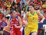 Australia's Hannah Kaser (right) races past Chile's Garcia Dayanne for the ball in a preliminary girls' basketball match. Australia beat Chile 12-4.
