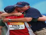 Vincent Hancock of the United States hugs coach Lloyd Woodhouse after Hancock won the gold medal in the men's skeet shooting event.