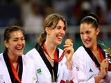 (L-R) Gold medalist Maria del Rosario Espinoza of Mexico, bronze medalist Natalia Falavigna of Brazil and bronze medalist Sarah Stevenson of Great Britain laugh during the medal ceremony for the Women's +67kg Taekwondo event.
