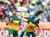 Cristiane of Brazil and Collette McCallum of Australia battle for the ball during the FIFA Women's World Cup 2011 Group D match between Brazil and Australia.