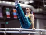 Brody-Jai Hennessy competes in the Parallel Bars section of the All Round Men's qualification.