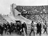 Berlin 1936: German dictator Adolf Hitler marches into the arena with entourage at the Opening Ceremony.