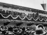 Garmisch-Partenkirchen 1936: German Fuhrer and Chancellor Adolf Hitler (1889 - 1945) (center, on balcony) greets the crowd during the snowy Opening Ceremony.
