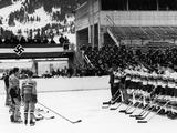 Garmisch-Partenkirchen 1936: Members of the Hitler Youth hockey team stand in a line on the ice, saluting after defeating the Hungarian team in the sixth Hitler Youth Winter Games.
