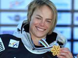 Holly Crawford collects gold in the halfpipe at the 2011 Snowboard World Championships in La Molina, Spain.