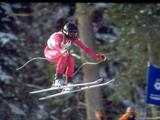 Holly Flanders of the United States flies through the air during her turn in the women's alpine skiing downhill event.