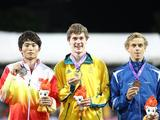 Silver medalist Wang Dongqiang of China, gold medalist Nicholas Hough of Australia and bronze medalist Jussi Kanervo of Finland (L to R) pose for group pictures during the awarding ceremony for the boys 110m Hurdle Final A.