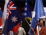 Ian Thorpe carries the Australian flag during the Closing Ceremony of the Sydney Olympic Games in 2000.