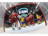Daniel Sedin #22 of Sweden celebrates his first-period goal with 