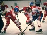 Eric Lindros (right) of Canada in action during the men's ice hockey match against the Czech Republic.