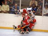 Mike Ramsey #5 of the United States checks a player from West Germany during a men's ice hockey game.