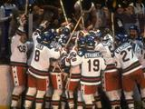 The USA team celebrate their win against Russia after the men's ice hockey final.