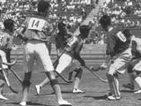 Los Angeles1932: The gold medal winning Indian team in action during the field.