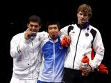 Medalists of Cadet Male Individual Sabre Song Jong Hun of South Korea (C,gold), Leonardo Affede of Italy (L, silver) and Richard Hubers of Germany (R, bronze) pose for photos on the podium during the awarding ceremony of fencing.