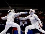 Anja Musch of Germany (R) competes with Gracia Makwanya of the Democratic Republic of the Congo during the Cadet Famale Individual Sabre round of 16. Anja Musch won by 15-2.