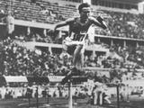 Berlin 1936: Volmari Iso-Hollo of Finland clears the water jump in the 3,000m steeplechase event and wins the gold medal with a time of 9:03.8 seconds.