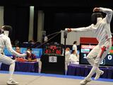 Andrea Micalizzi of Italy and Jan Szalay of Slovakia compete during the Mixed Relay fencing match of Modern Pentathlon