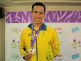 Swimmer Justin James beams with his silver medal from the 4x100m mixed relay.