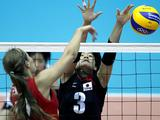 Ichikawa Chizu (R) of Japan blocks ball during the Girls Volleyball Semifinal match. USA won by 3-0.