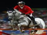 Eiken Sato of Japan and Cayak jump a fence during the Jumping Individual 2nd Qualifier held at the Hong Kong Olympic Equestrian Venue.