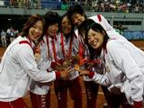 Players from Japan receive their gold medals after they beat the United States 3-1 during the women's grand final gold medal softball game.