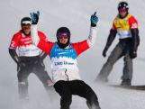 Jarryd Hughes of Australia celebrates his win in front of Konstantin Schad of Great Britain and Alex Deibold of the US during the men's finals at the 2013 Snowboard Cross World Cup in Lake Louise, Canada.