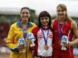 Gold medalist Ekaterina Bleskina of Russia (C), silver medalist Michelle Jenneke of Australia (L) and bronze medalist Noemi Zbaeren of Switzerland attend the victory ceremony of the girls 100m hundles final A at Bishan Stadium of the Singapore 2010 Youth Olympic Games in Singapore, August 21, 2010.