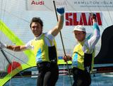 Iain Jensen and Nathan Outteridge celebrate winning the 49er Men's Skiff Medal race during the ISAF Sailing World Championships in Perth, Australia.