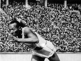 Berlin 1936: Jesse Owens of the United States in action in the mens 200m. Owens won a total of four gold medals in Berlin, winning the men's 100m, 200m, the long jump as well as being part of the 4x100m relay team.