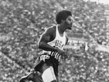 Munich 1972: American John Smith, ranked number one in the world in the 400m, runs a heat with a hamstring injury, unable to participate in the men's 400m event.  Smith went on to a brilliant career coaching Olympians and UCLA atheletes.