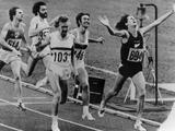 Montreal 1976: New Zealander John Walker stretches his arms out after crossing the finish line to win the men's 1,500m final.