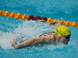 Australia's Zoe Johnson swims the butterfly leg of the Youth Women's 4X100m Medley Relay. Australia won the gold.
