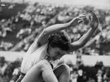 Helsinki 1952: Australia's Verna Johnson leaps into the sand in the first series of the ladies long jump qualifying event. She finished eighth.