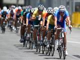 Competitors take up a pack formation in the junior men's road race held at The Float@Marina Bay in Singapore