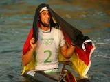 Alexander Grimm of Germany celebrates after winning the gold medal the Kayak (K1) Men's Final held at the Shunyi Olympic Rowing-Canoeing Park on Day 4 of the Beijing 2008 Olympic Games on August 12, 2008 in Beijing, China.