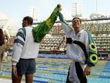 Australia's Kieren Perkins waves to the crowd after winning the men's 1500m freestyle event.