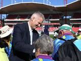 Five-time Olympian and Australian Team flagbearer at Sydney 2000 Andrew Gaze signs autographs for hundreds of volunteers at the reunion at Sydney Showground, Sydney Olympic Park on 15 September 2010.